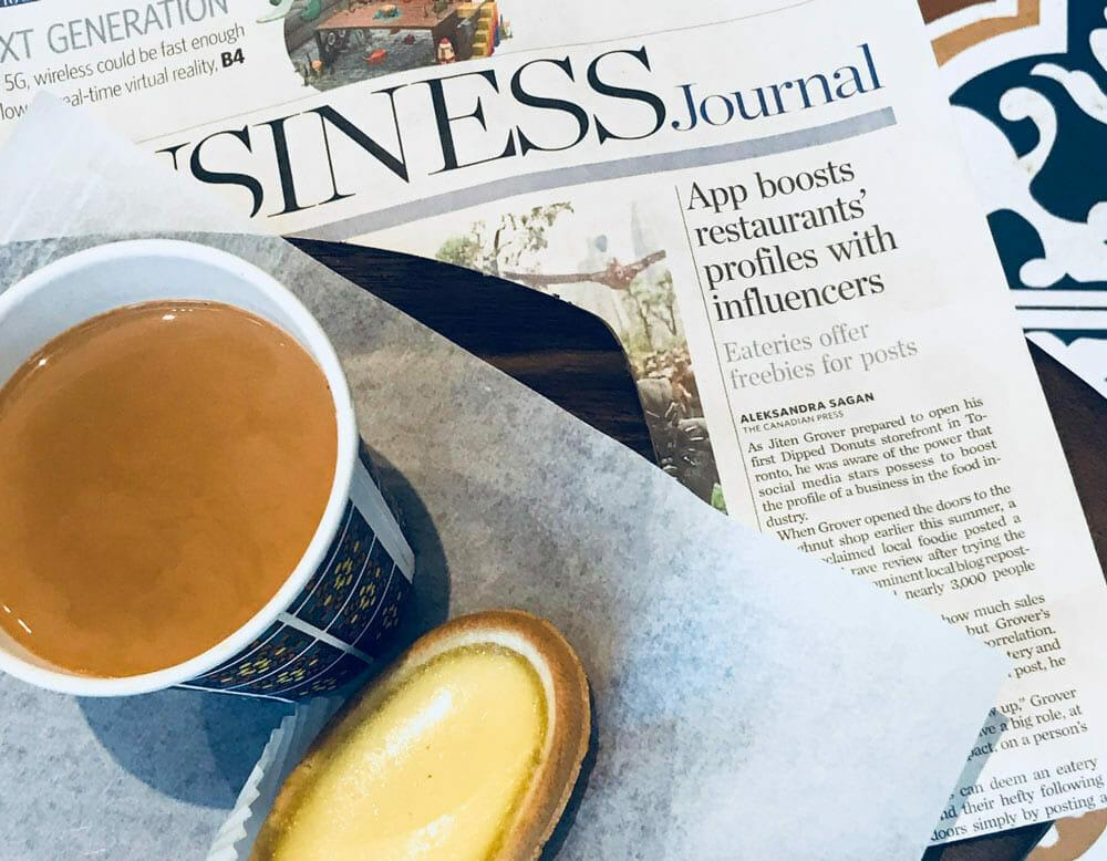 Newspapers Feature of Node with a cup of tea and dessert.