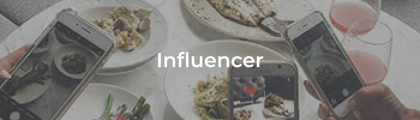 A Influencer button with Influencer's taking pictures of food as the background.